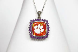 "Made for the biggest Clemson fan! This is a one-of-a-kind piece.   Features:  Amethyst accents Man made opal center 14k gold Cable chain with lobster clasp 18"" chain Officially licensed product  Pendant box included"