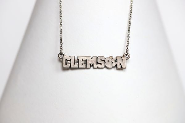 Celebrate the 2016 Clemson Tigers Football National Championship victory!  Features:  Sterling silver Purple and yellow enamel Lobster clasp Officially licensed product Pendant box included