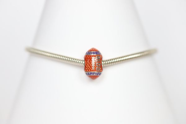 Celebrate the Clemson Tiger Football National Championship legacy! Choose your football charm and bracelet length!   Features:  Sterling silver Lobster clasp Enamel Double sided charm Officially licensed product