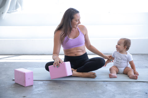 Mommy and me yoga in sweat and milk's oceane 2 nursing sports bra