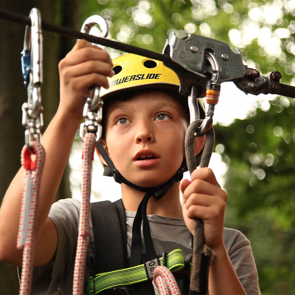 boy holding harness