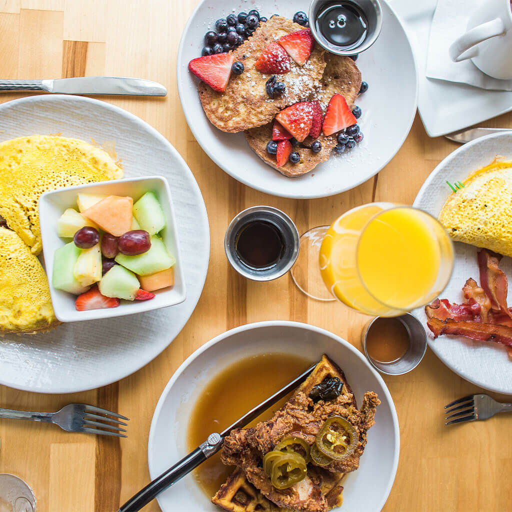 variety of breakfast meals on table