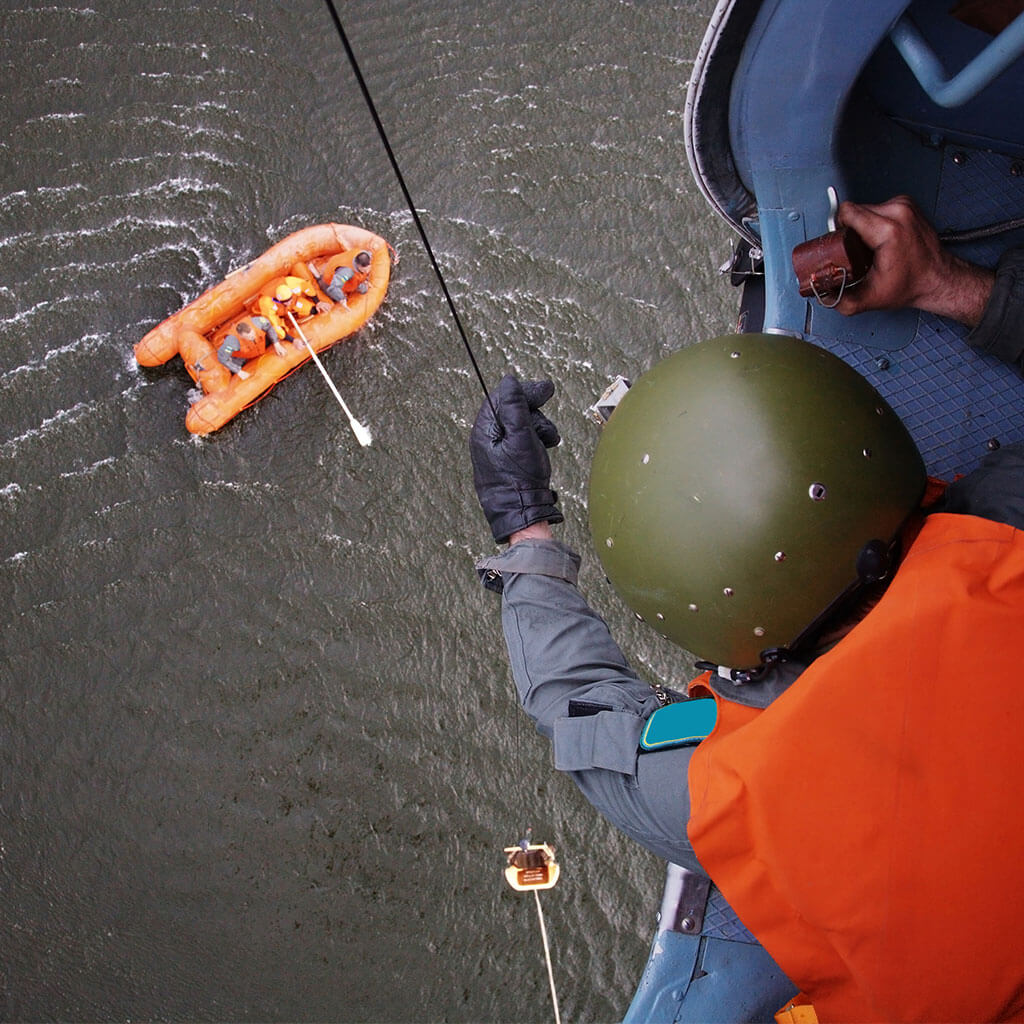coast guard rescuing survivors from raft