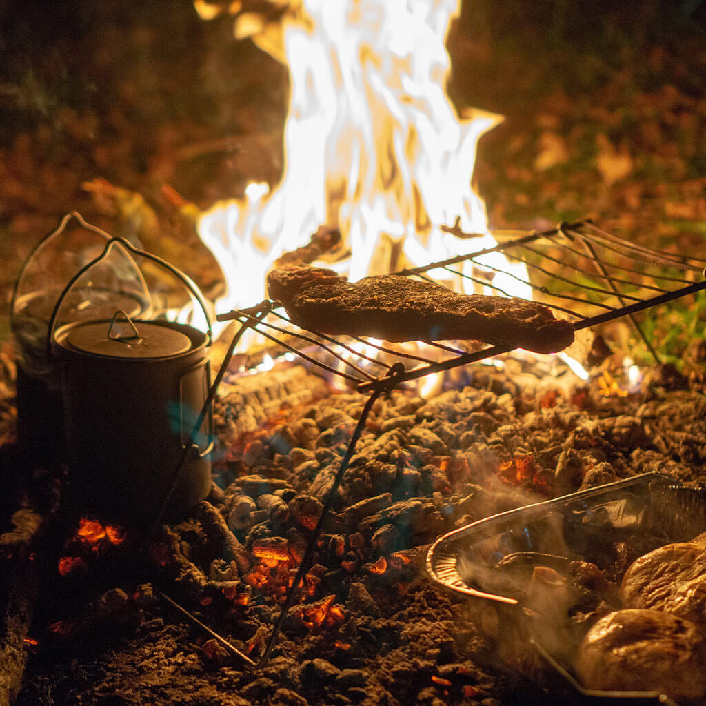 cooking over campfire in the backcountry