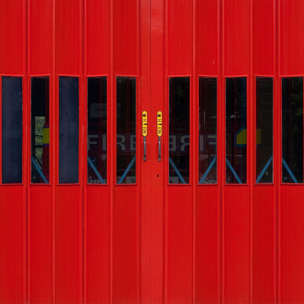 fire truck behind red doors
