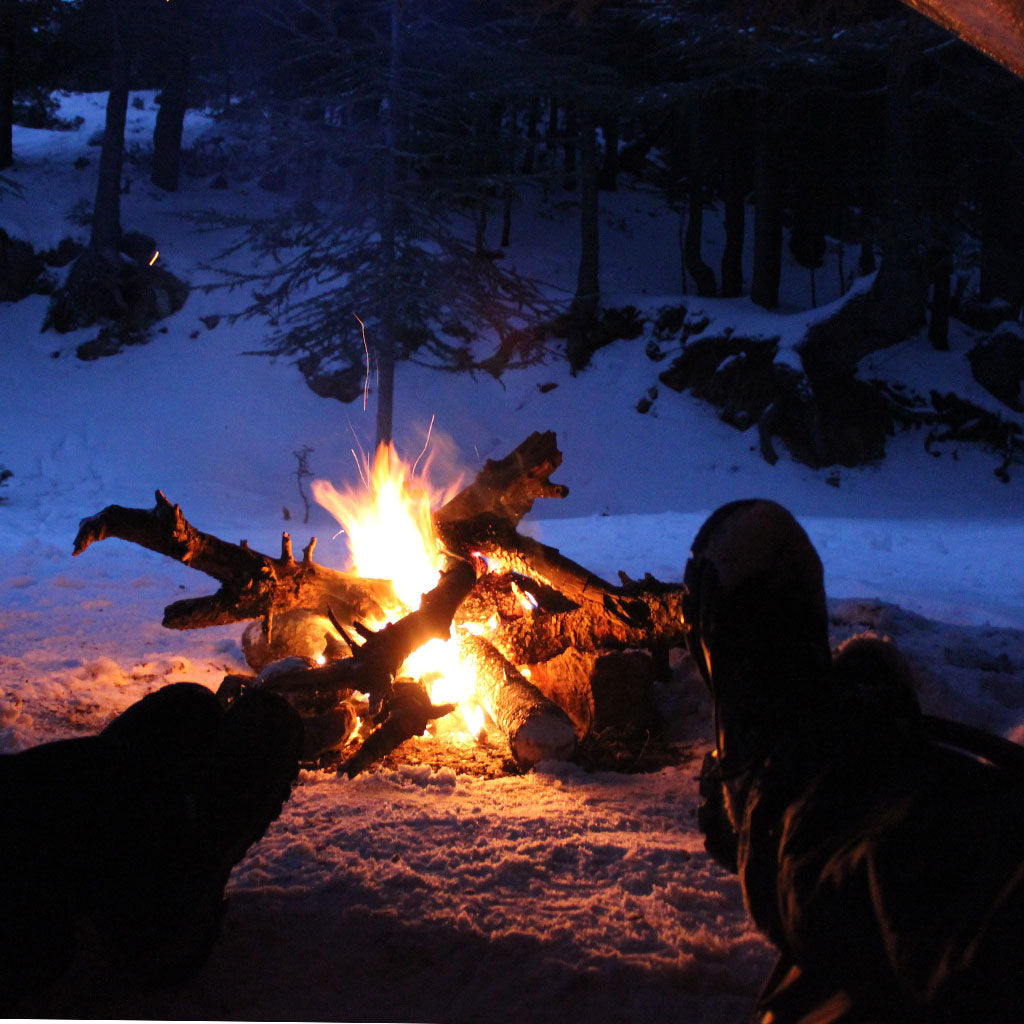 fire outside of tent in winter