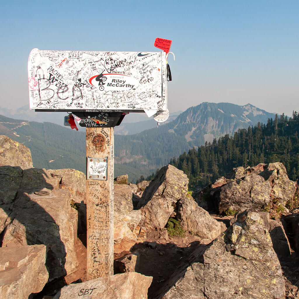 mailbox on top of mountain peak with flag up