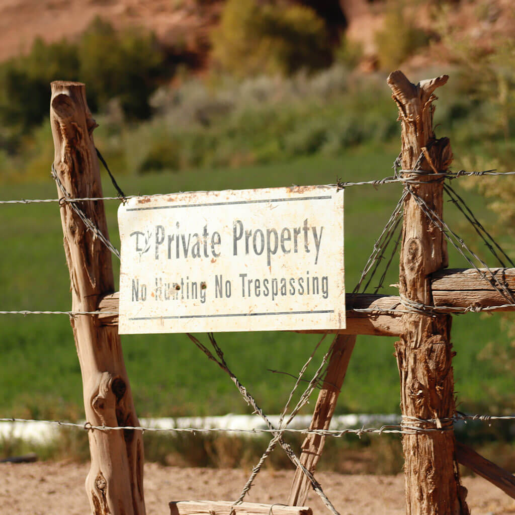 Private property sign posted on fence