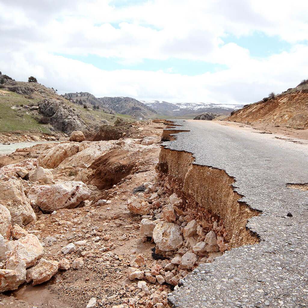paved road torn apart by earthquake