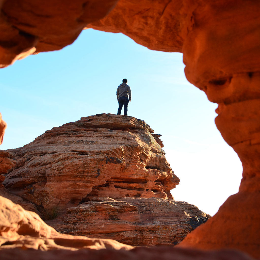 person standing on rock in st. george utah