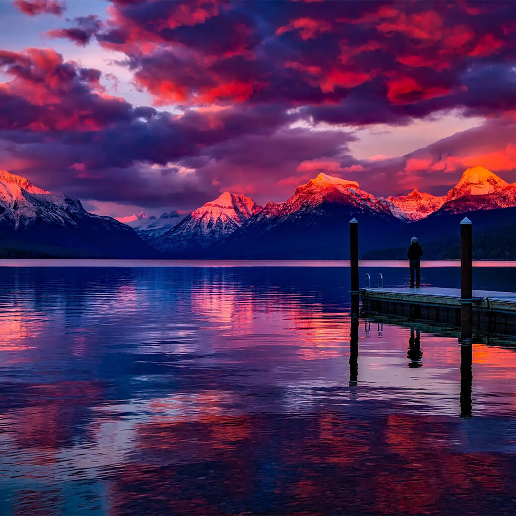 purple clouds at sunset at mountain lake