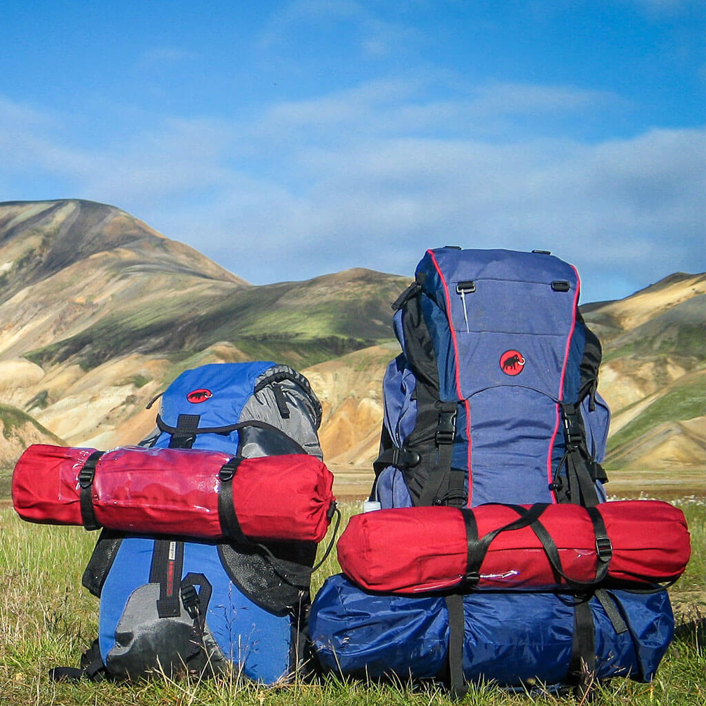 two loaded hiking backpacks