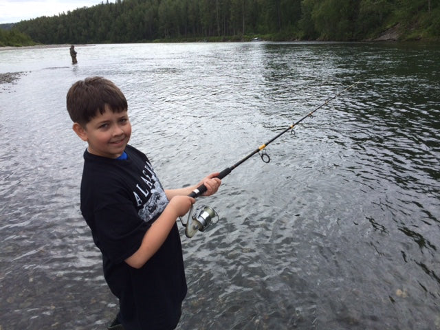 Danial Hillenburg fishing in river