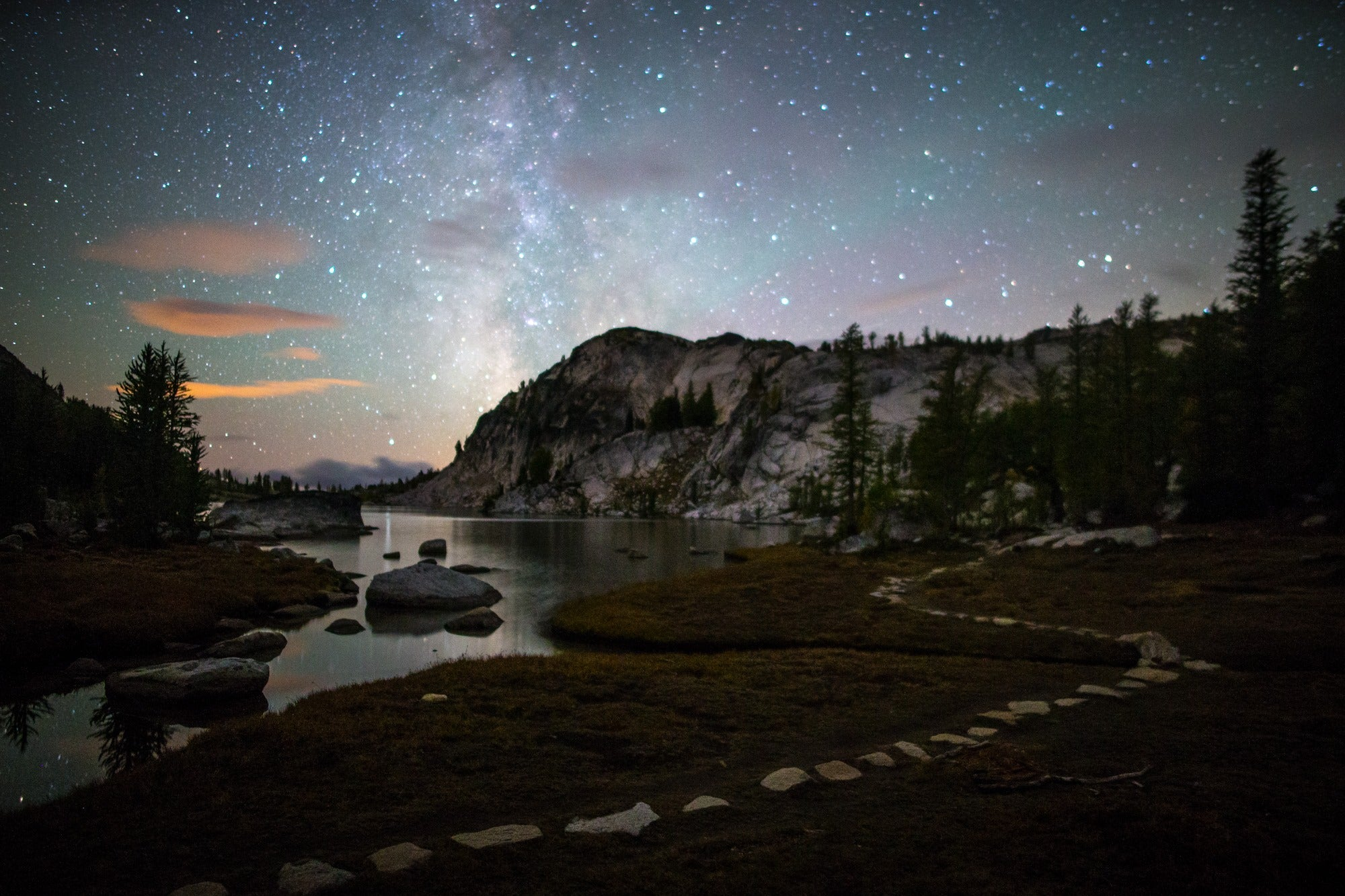 Starry sky with mountain and river at Perfection Lake Trail, Enchantment Basin, WA