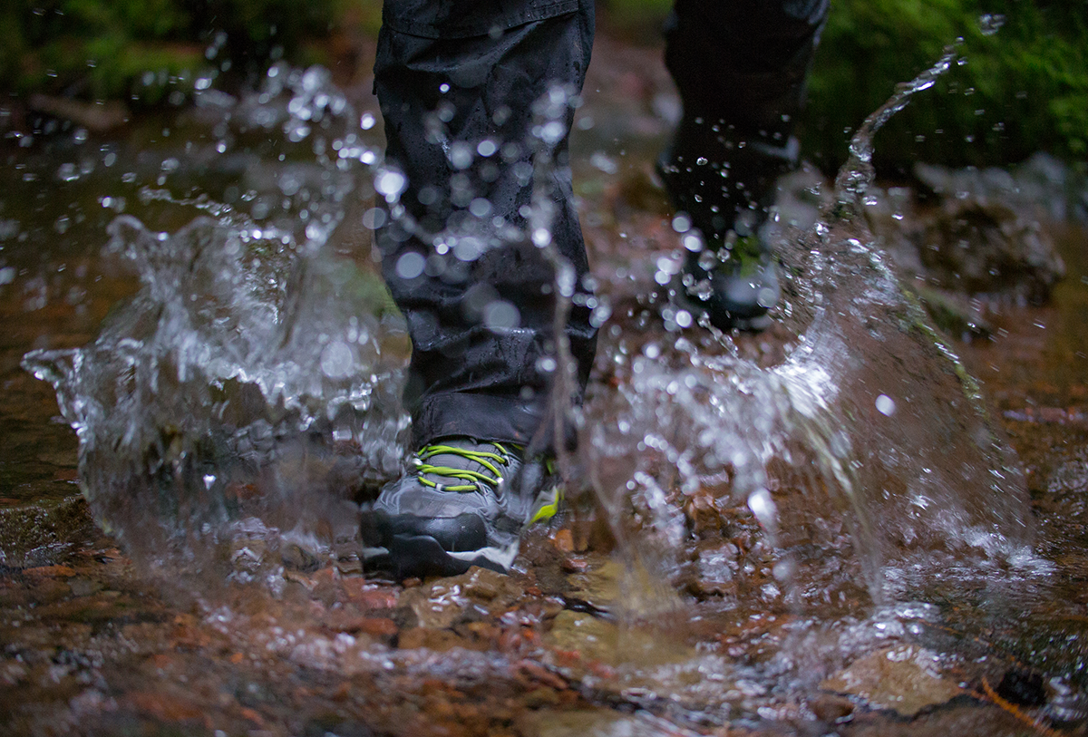 Person walking through water in keen shoes