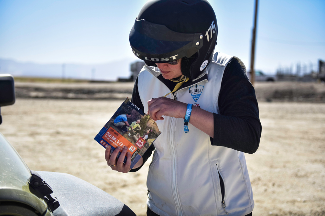 Rebelle Rally rider eating out of a Mountain House pouch
