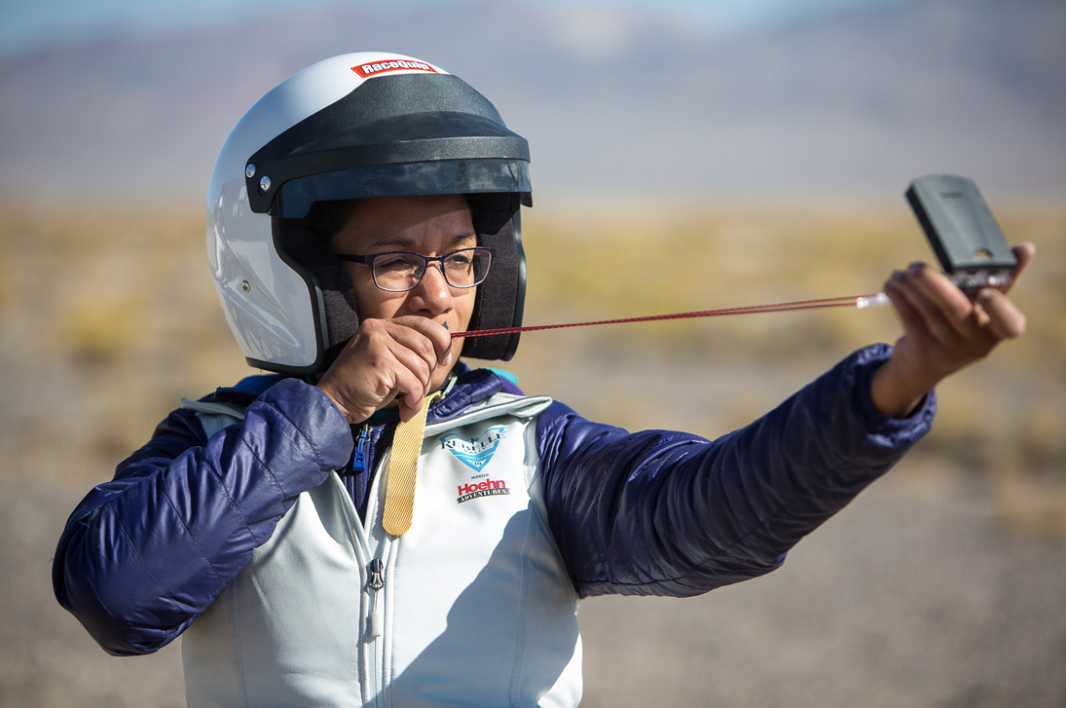 Rebelle Rally participant using a compass