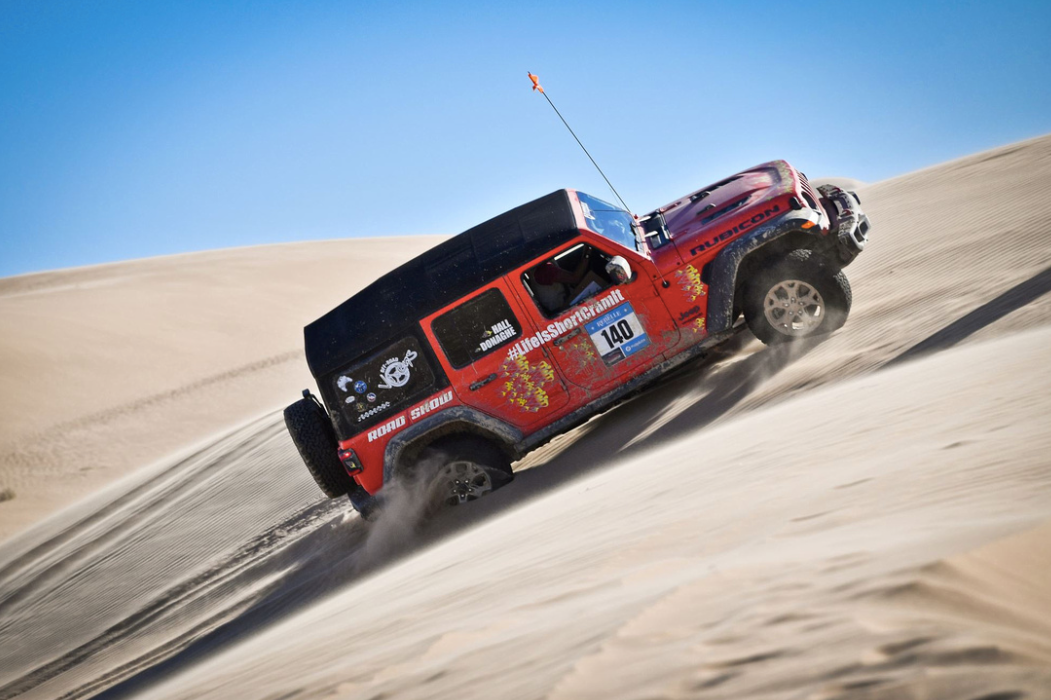 Off-roading up a sand dune.