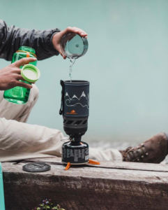 Person pouring water into a JetBoil