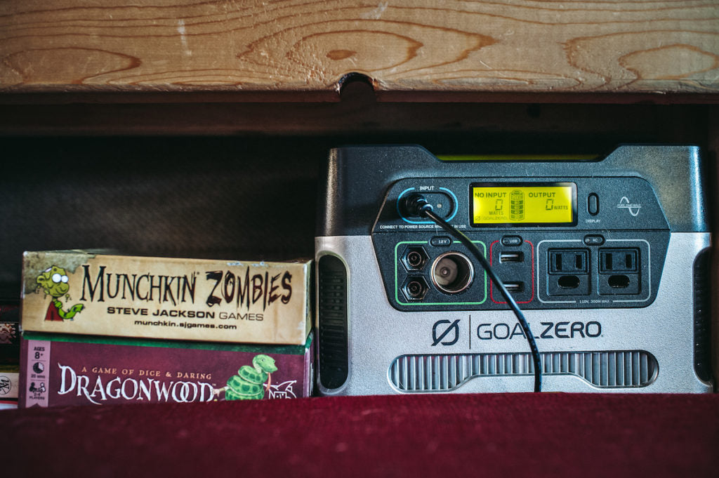 The console of a GoalZero unit with a couple of boxed board games next to it.