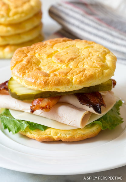 turkey sandwich with bacon, lettuce and pickle on cloud bread