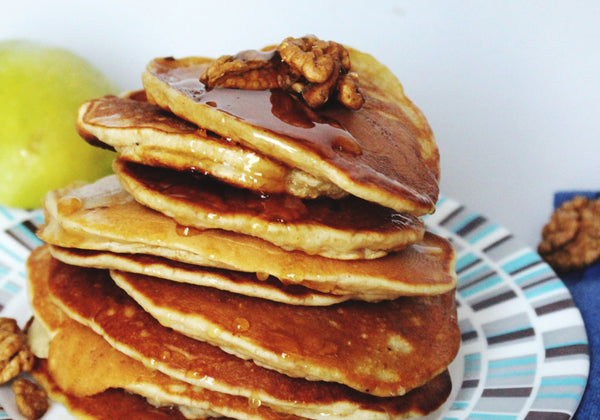 stack of beer pancakes with syrup and pecans