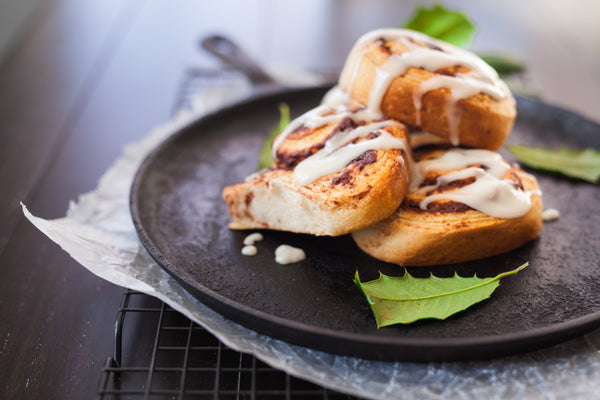 cinnamon roll-ups on black pan
