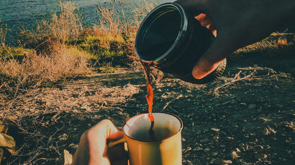 Pouring coffee while backpacking