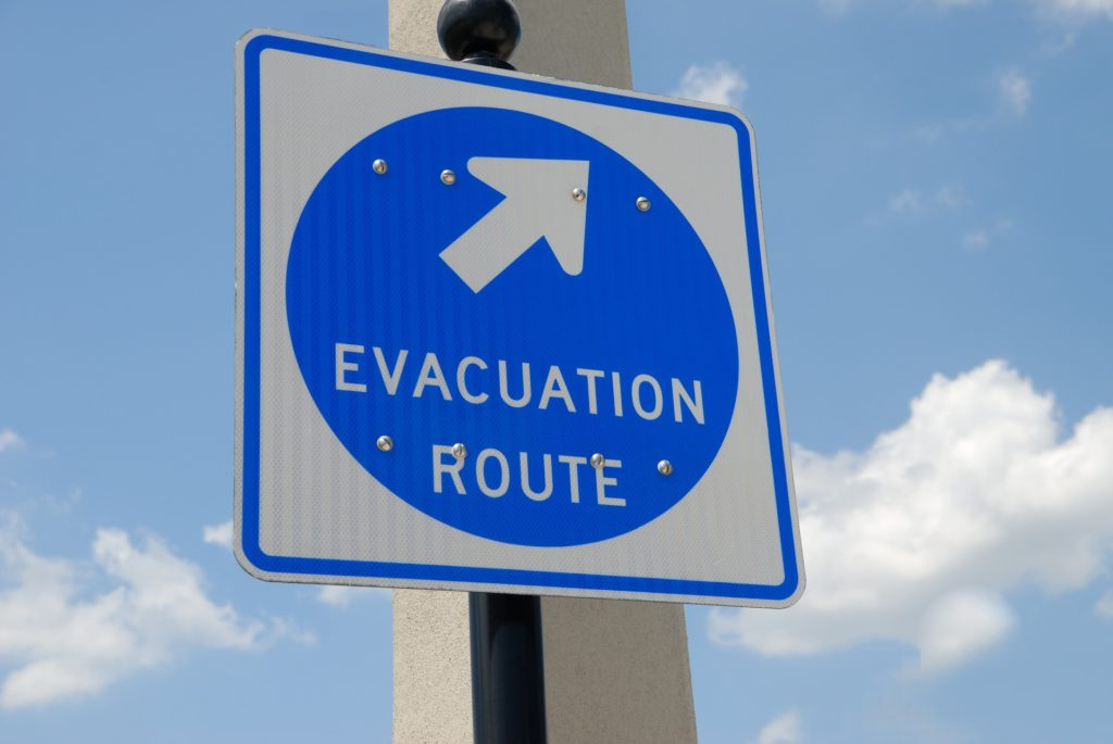 Blue evacuation route road sign.