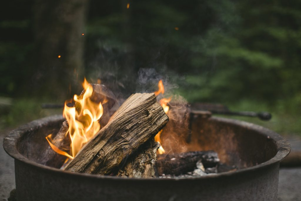 Firewood in fire ring.
