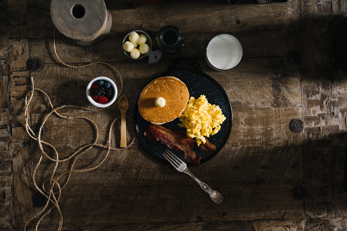 breakfast skillet with eggs and pancakes