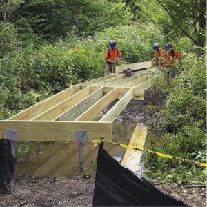 group of people building hiking trail frame