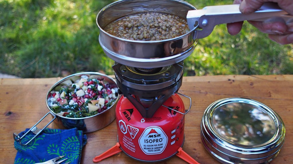 Lentils cooking on a backpacking stove