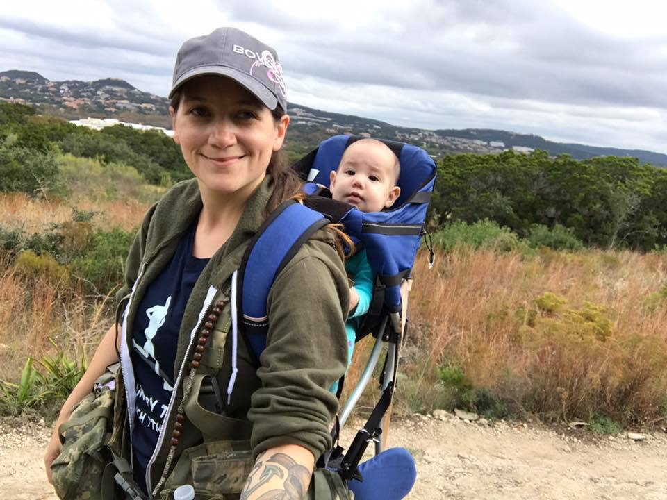 Mountain House ambassador Morgan hiking with Baby Rogue on her back.