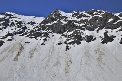 Avalanches coming down mountain peaks.