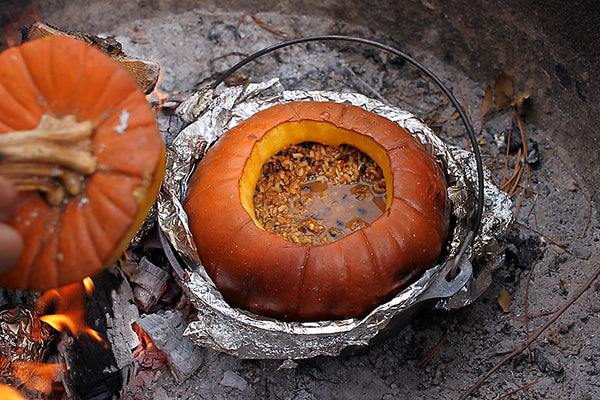 pumpkin in foiled pot sitting in campfire