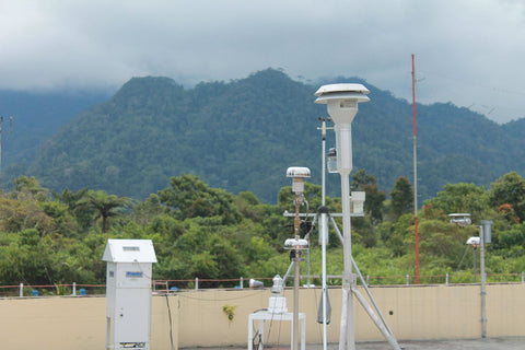 Meteorological weather equipment in cloudy, tropical hills.