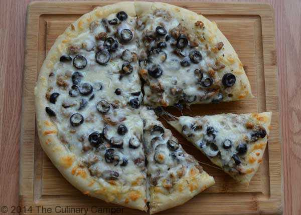 round pizza with olives and cheese