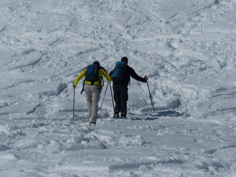 Winter backpackers cross-country skiing.