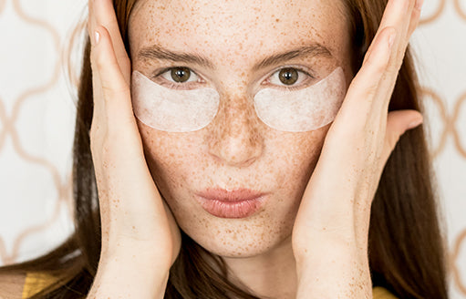woman using under eye gel patches by babe lash