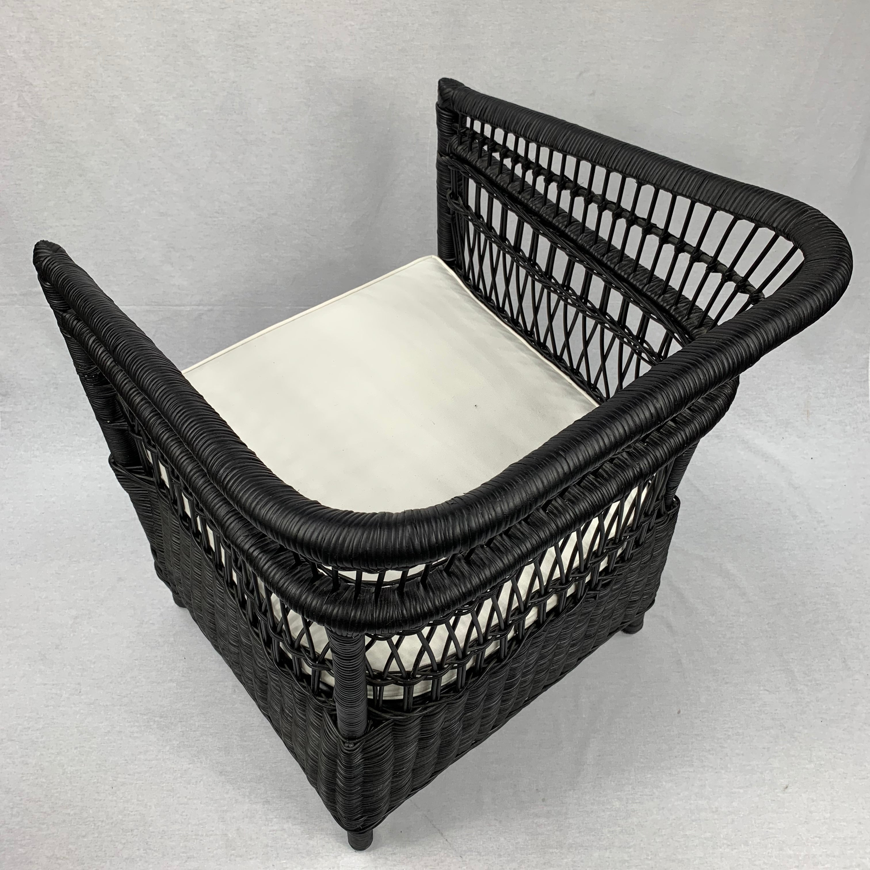 RATTAN BLACK CHAIR WITH ECRU COLOURED CUSHION