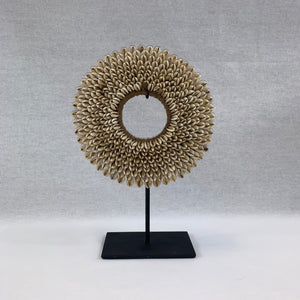 SMALL DECORATIVE SHELL NECKPIECE ON METAL STAND