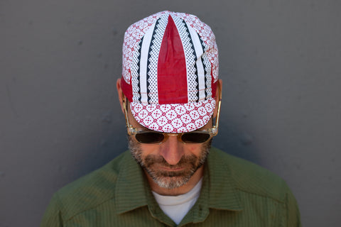 red + white Kenya caps