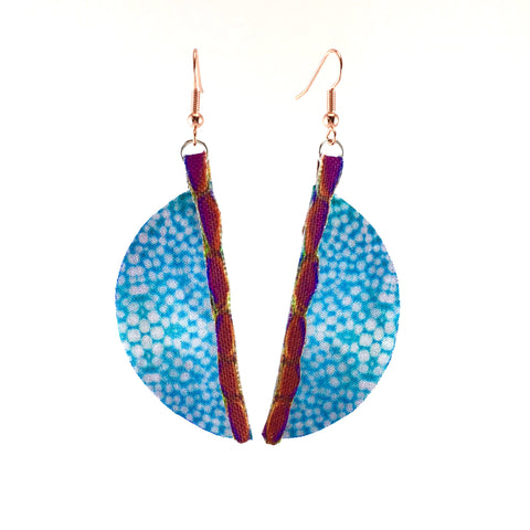 blue nettle print earrings fabric half circle design with purple pink edging tabs and copper plated ball and wrap fish hooks front