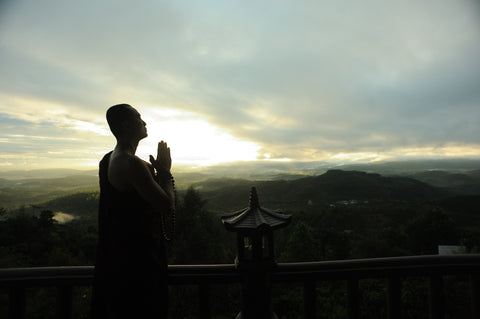 Monk, praying, mountain