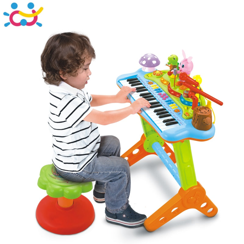 HUILE TOYS 669 Kids Musical Toy Electronic Keyboard Musical Organ With Microphone, Stool, Teaching Light up Keys, Dancing Animal
