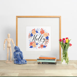 custom made artwork for nursery. hand lettered baby name with a floral wreath, made in nz