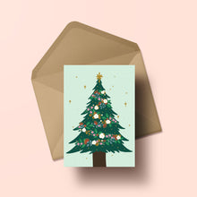 Load image into Gallery viewer, A Christmas tree decorated with garlands of beautiful NZ flora with holly and bright stars, all set against a mint green background.