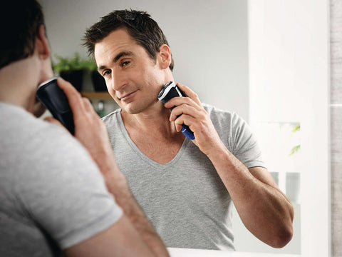 PICTURE OF MAN USING AN ELECTRIC SHAVER