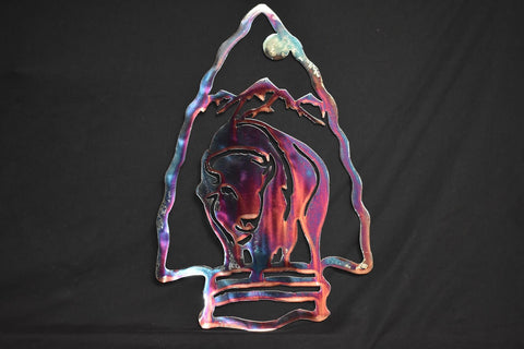 Gorgeous metal art of a buffalo inside an arrowhead with a colorful patina effect